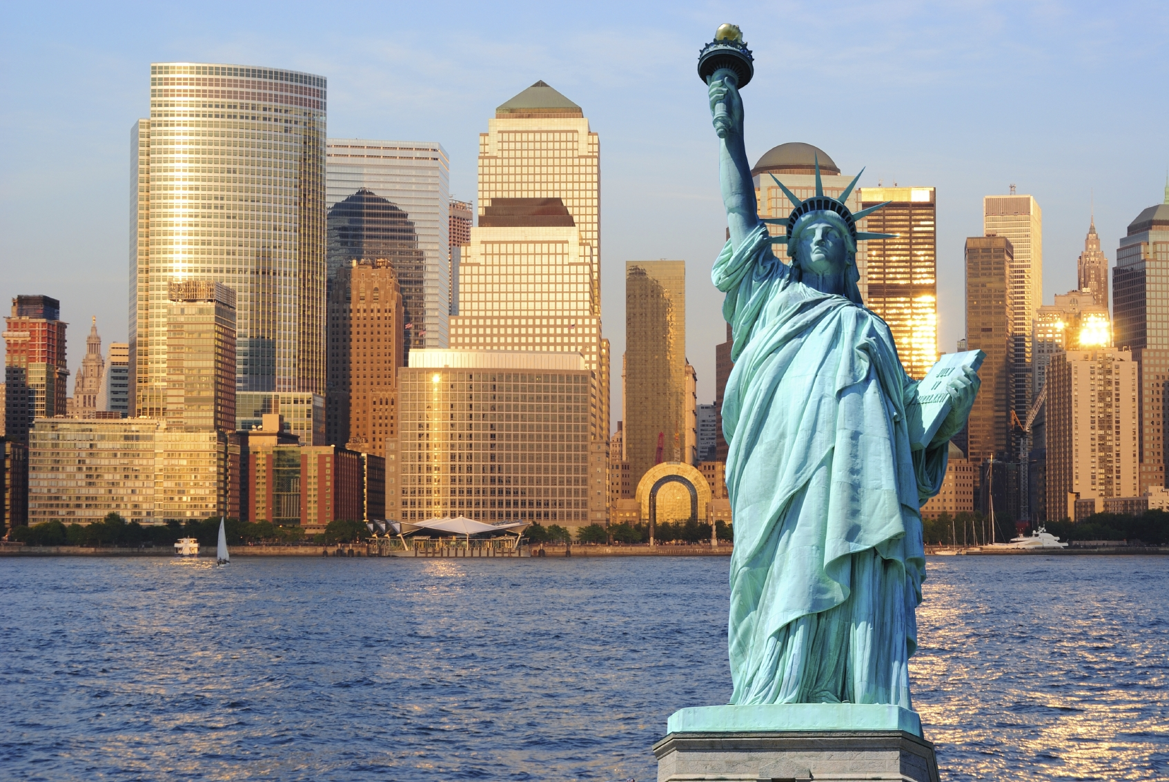 The statue of liberty against the New York City skyline.